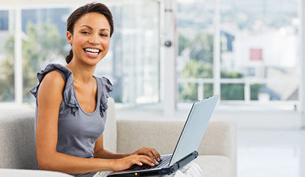 picture of a woman and her laptop
